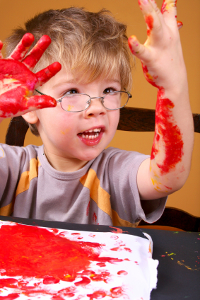 boy with fingerpaint
